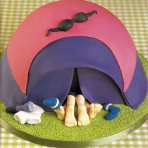 Naughty Couple best of luck Cake hiding inside an igloo shaped cover with only legs remaining out. Adult Cake shape