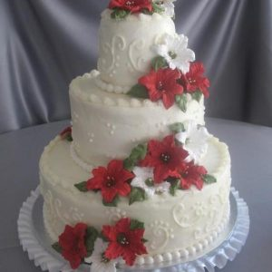 A 3 tier anytime delivery cale with roses decorated on it