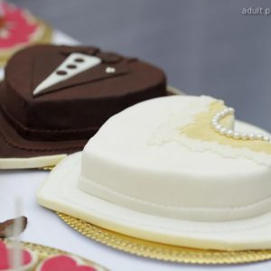 Love pre-wedding cake for couple celebrations in Heart Shape. A pair of black and white cakes