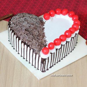 Milti personality Black and Red half-half decorated black forest cake with fine artistry