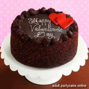 Brown cake with 2 red cream hearts on top for Valentine Day lovers