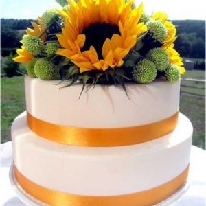 2 tier cake with sunflowers on top for decoration of the cake