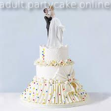 A Fondant designer Cake showing Couple ball dancing on top of cake terrace